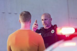 Policeman performing sobriety test on driver
